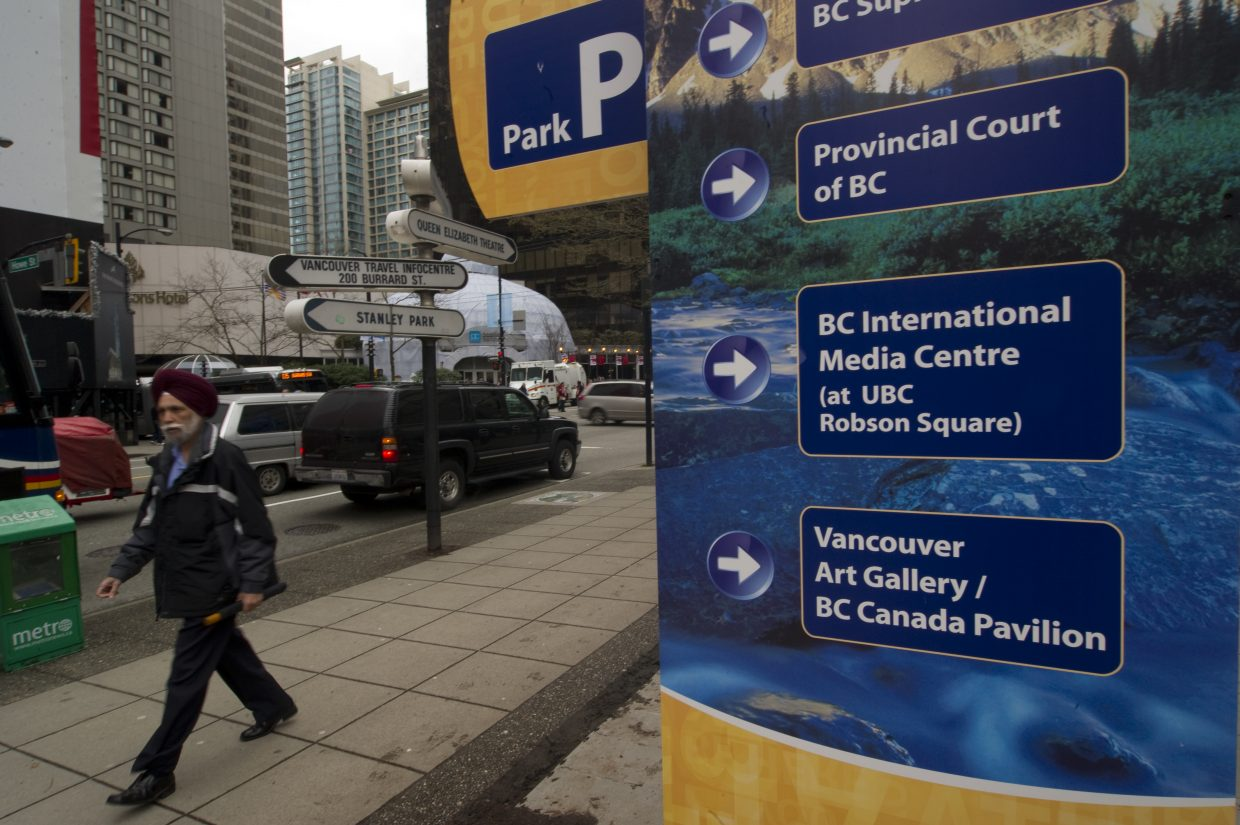 Signs point the way for visitors to Vancouver.