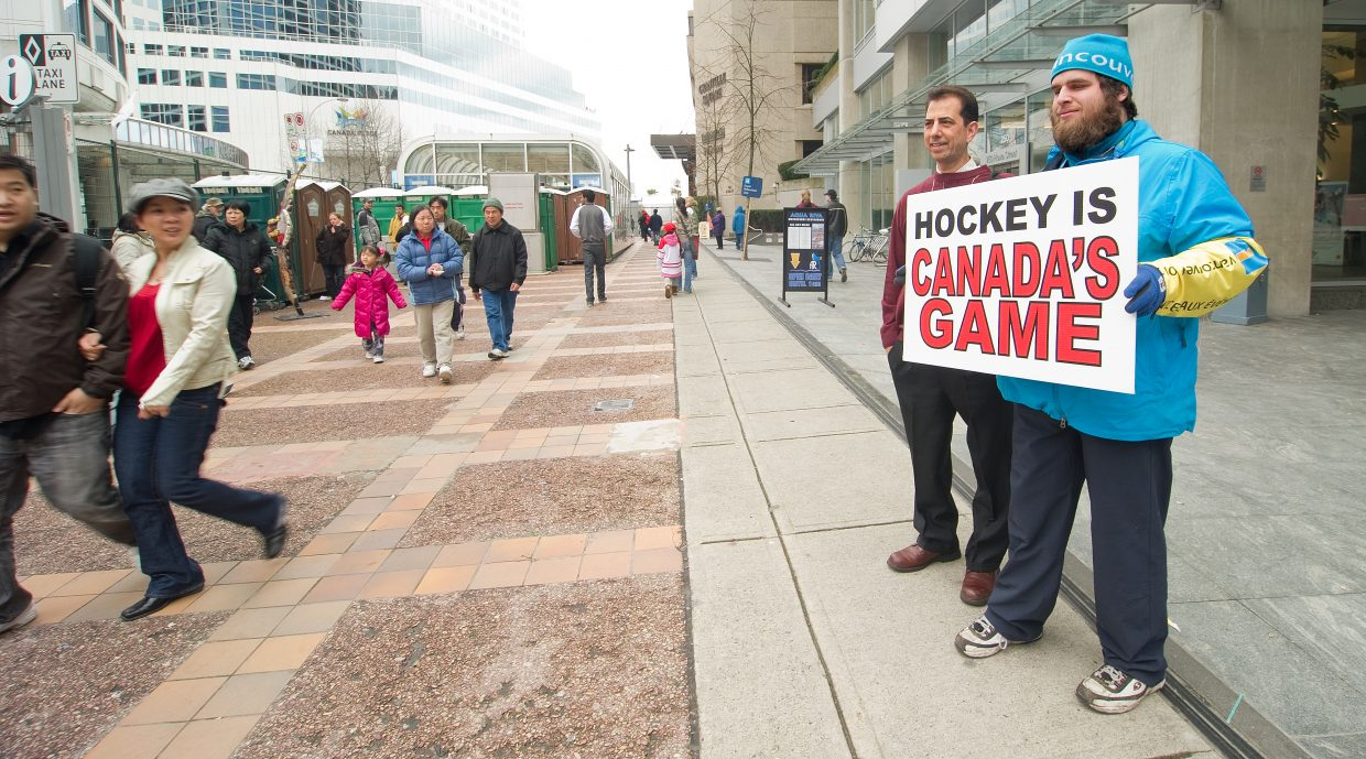 Olympic volunteer Michael Leahy can't help but show his support for the home team the day of the United States vs. Canada hockey game in Vancouver, British Columbia. The Canadians won the game in overtime, to help prove Leahy's point.