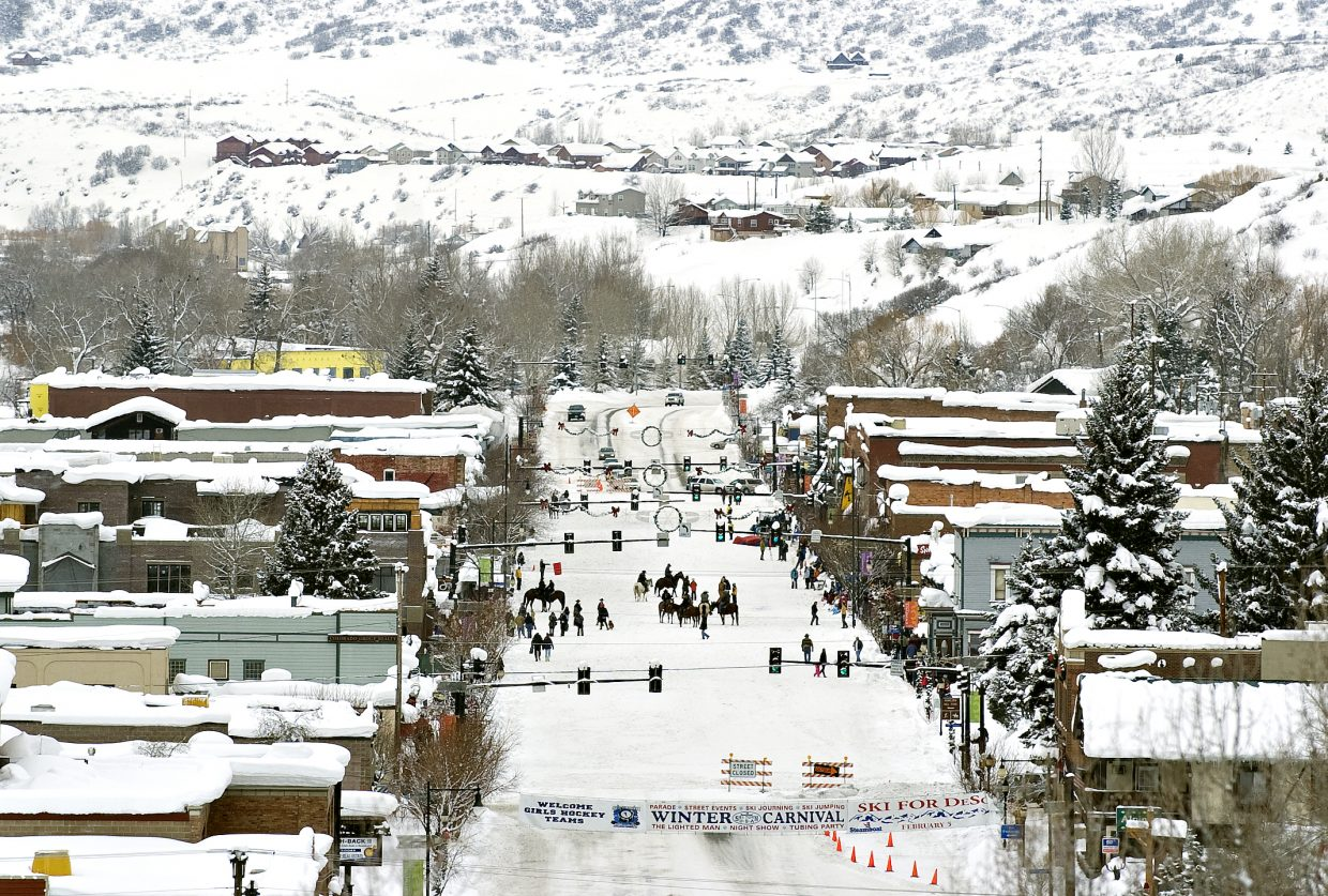 Locals gather on horseback and on skis to participate in the 95th annual Winter Carnival on Lincoln Avenue in Steamboat Springs on Saturday morning.