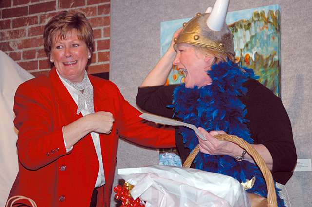 Alice Klauzer, first president and director emeritus of the Steamboat Springs Arts Council, presented former executive director of the Arts Council Nancy Kramer, right, with a parting gift from council affiliates at Kramer's retirement reception Jan. 25.