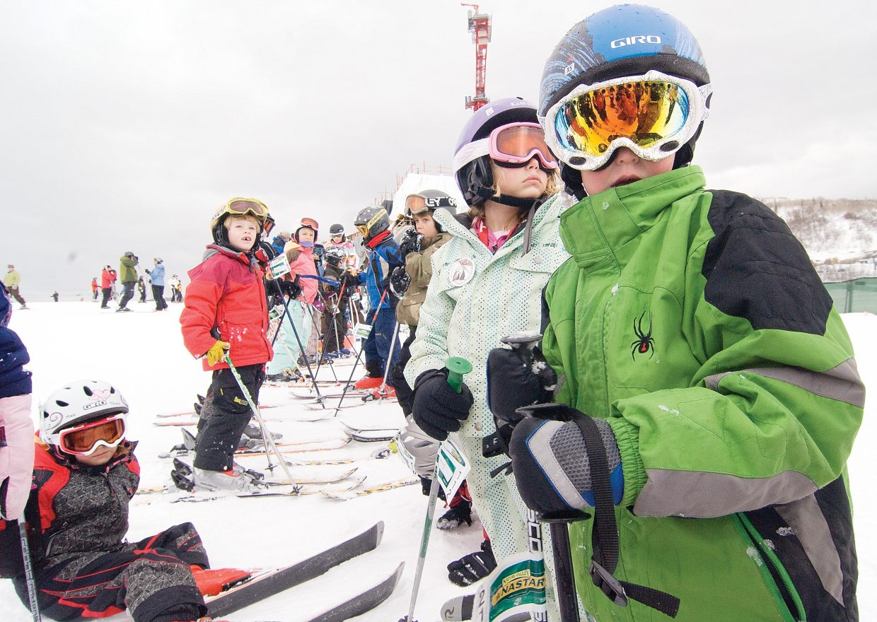 """Seven-year-old Will Martin waits for his turn at the gates at the 2009 Soda Pop Slalom at Steamboat Ski Area on Friday afternoon. Hundreds of young ski racers took a shot at the course and were rewarded with a """"Goody bag"""" and the traditional can of soda pop."""