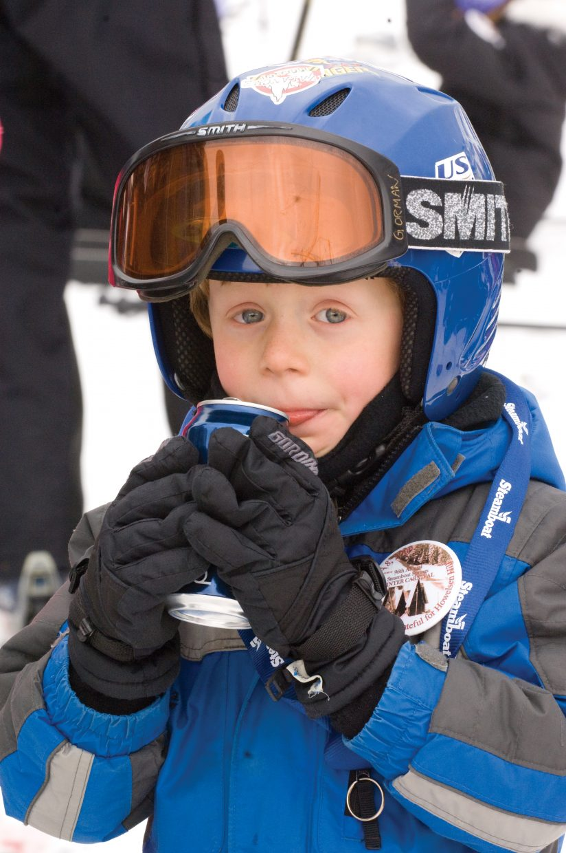 Ski racer Tommy Meissner enjoys a cold beverage after slipping through the gates at the 2009 Soda Pop Slalom at the Steamboat Ski Area on Friday.