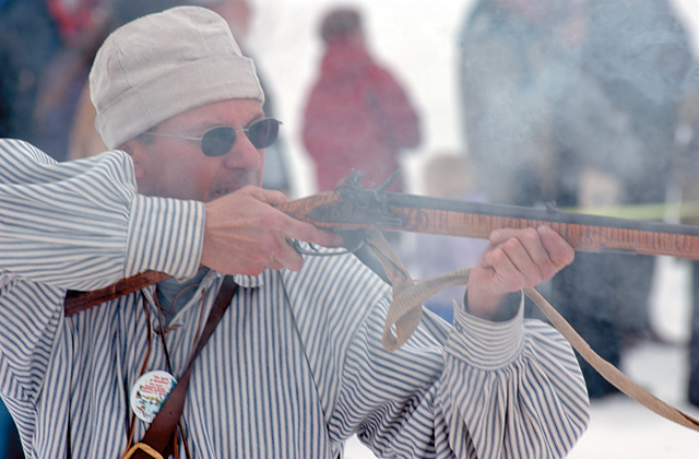 Mike Bieron takes aim during the muzzle-loading ski biathlon at Winter Carnival in February.