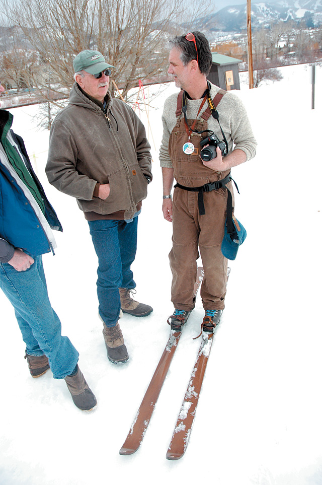 At Home writer Tom Ross, right, stops to chat with Kirk Wolff while photographing the muzzle-loading ski biathlon. Ross was wearing 1930s-era wooden skis.