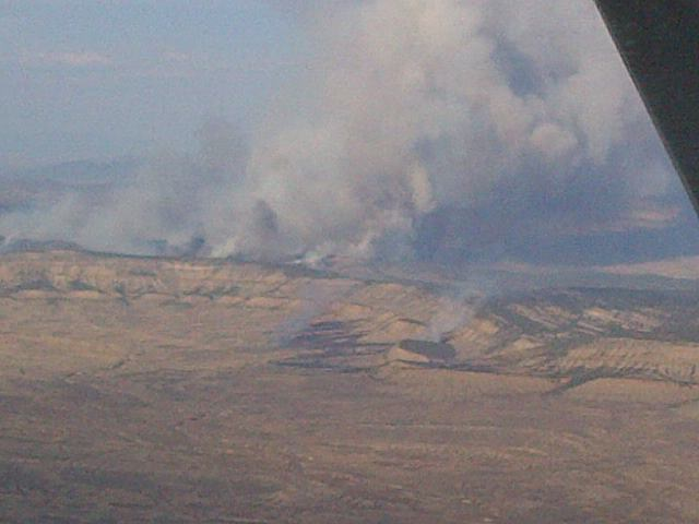 This ariel photo shows the southeast corner of the Wolf Fire on Friday.