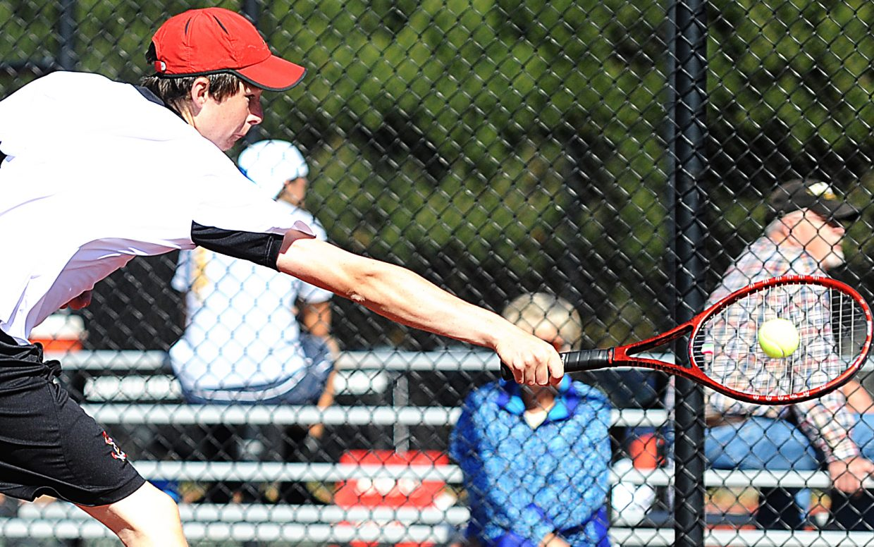 Jamey Swiggart catches a volley Friday at the state tennis tournament in Pueblo.