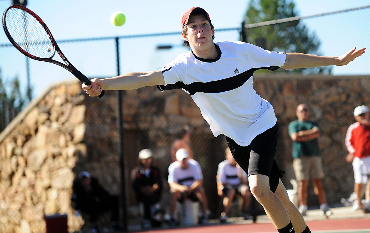 Jamey Swiggart leans for a return Friday at the state tennis tournament in Pueblo.