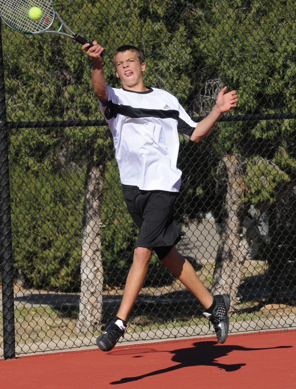 Steamboat junior Keegan Burger leaps to return a ball Friday in the consolation semifinals of the state tennis tournament in Pueblo. Burger won the match in two sets, rallying from deep deficits in each to claim a spot in today's third-place match. Steamboat's No. 4 doubles team of Gabri Erspamer and Kyle Rogers also qualified for the consolation finals.