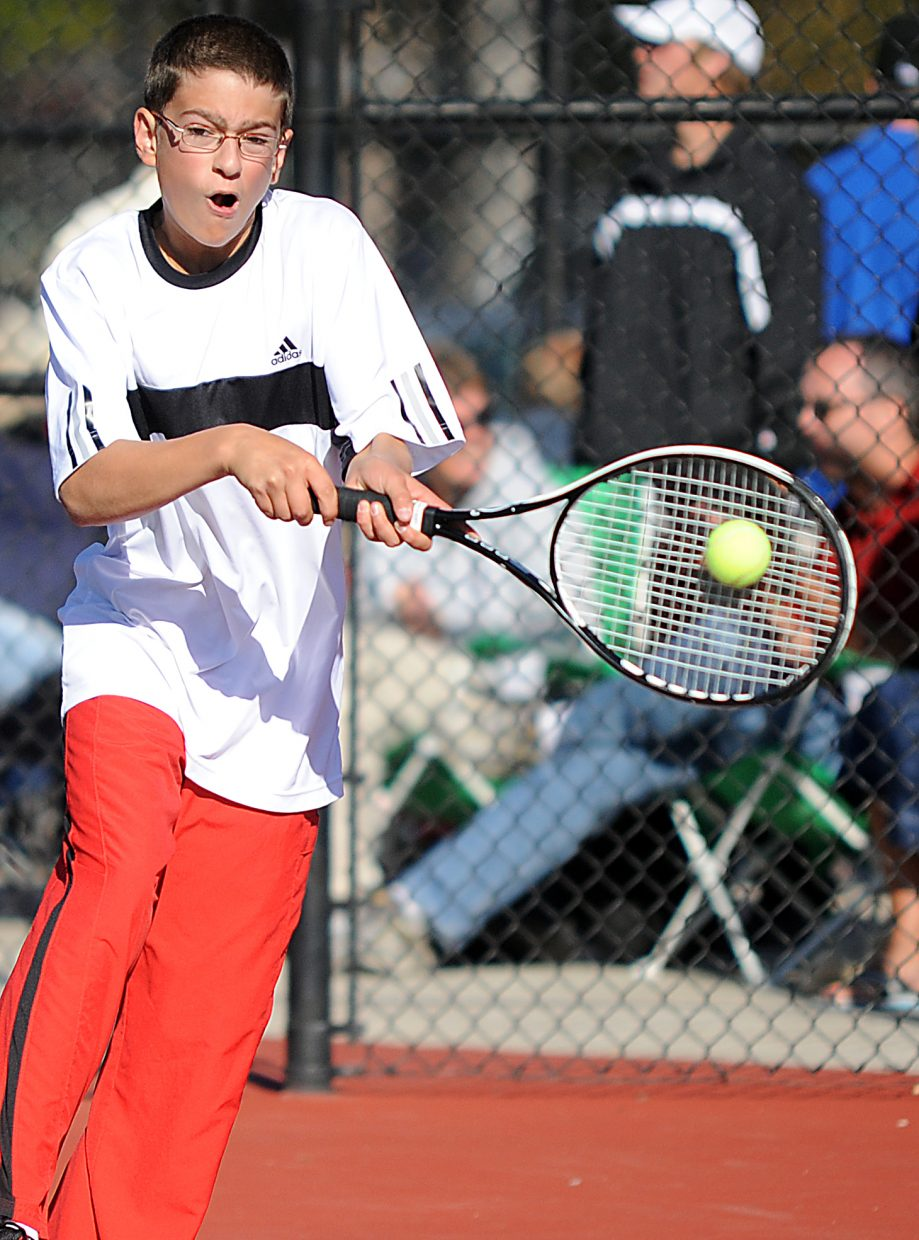 Kyle Rogers connects with a ball Friday at the state tennis tournament in Pueblo. After losing in the championship semifinals in the morning, Rogers and teammate Gabri Erspamer won their No. 4 doubles consolation match to advance today to play for third place.