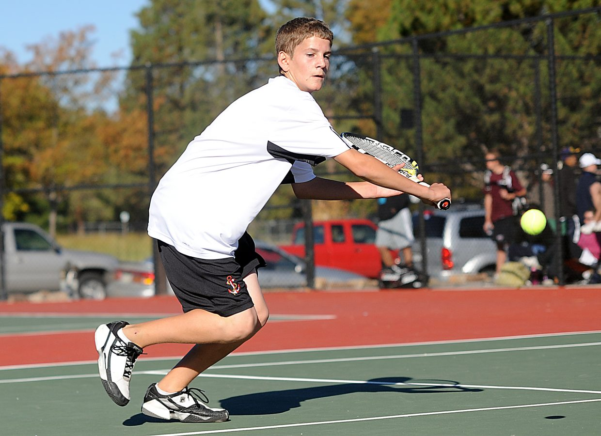 Gabri Erspamer reaches for a ball Friday at the state tennis tournament in Pueblo.