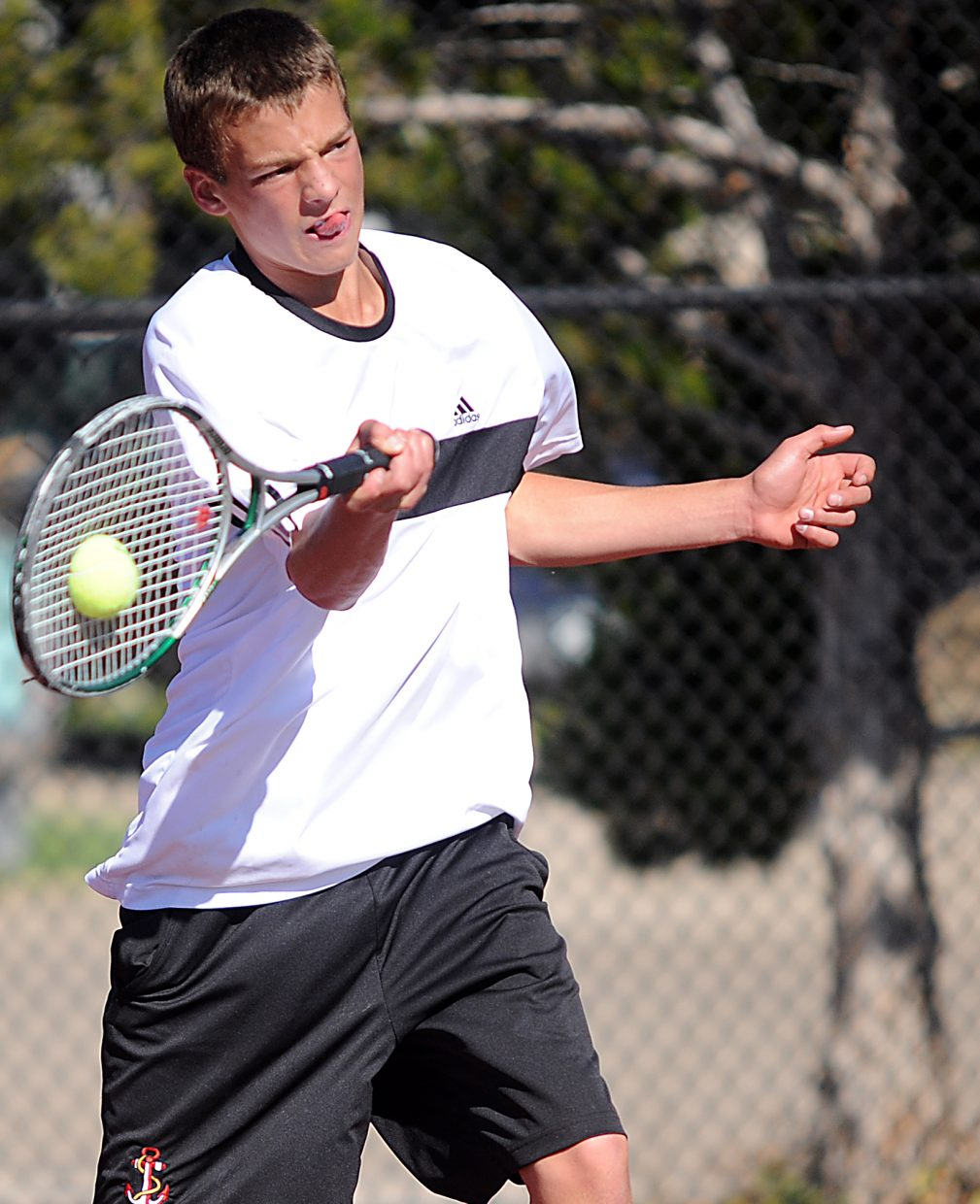 Keegan Burger crushes a return Friday at the state tennis tournament in Pueblo.