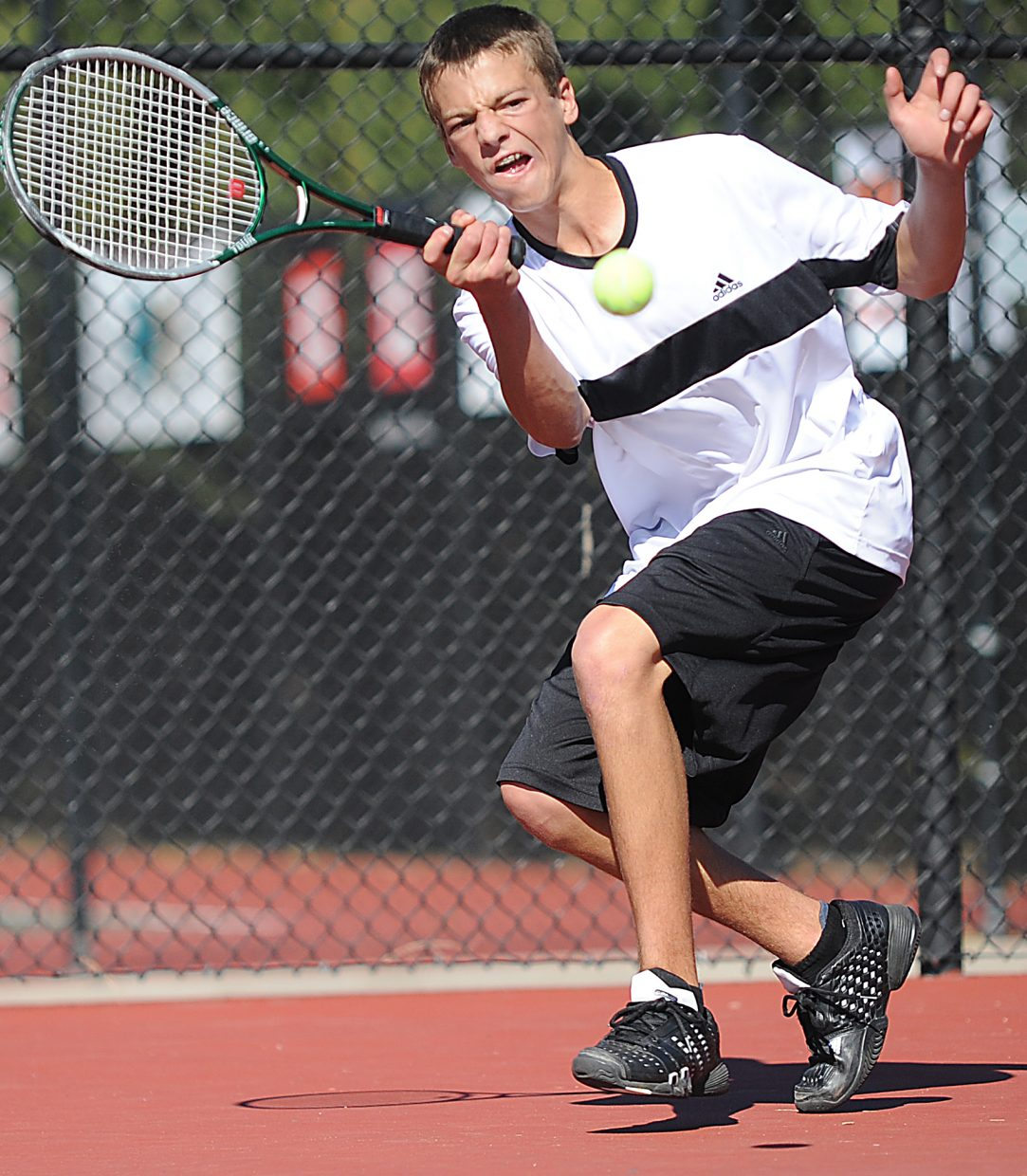 Keegan Burger eyes the ball Friday at the state tennis tournament in Pueblo.
