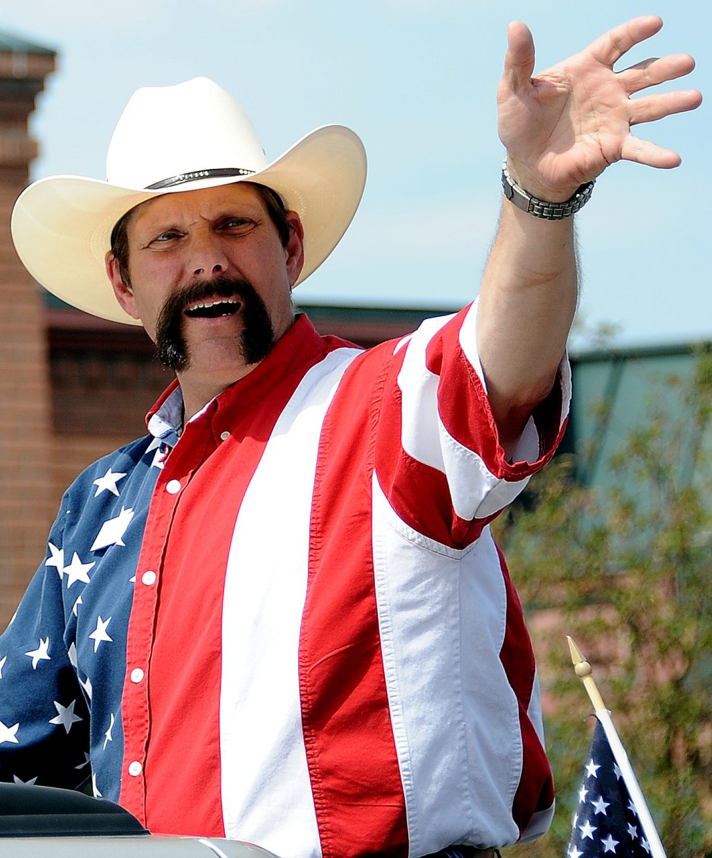 Randy Baumgardner waves to the crowd during the Fourth of July parade in Steamboat Springs.