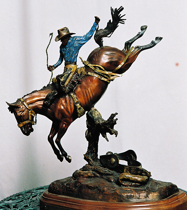 Bronze sculpture by Don Beeler. The cowboy is Robert Etbauer riding his horse named Bobby Joe Skoal. Etbauer is a two-time world champion saddleback rider and his horse is a three-time world champion.