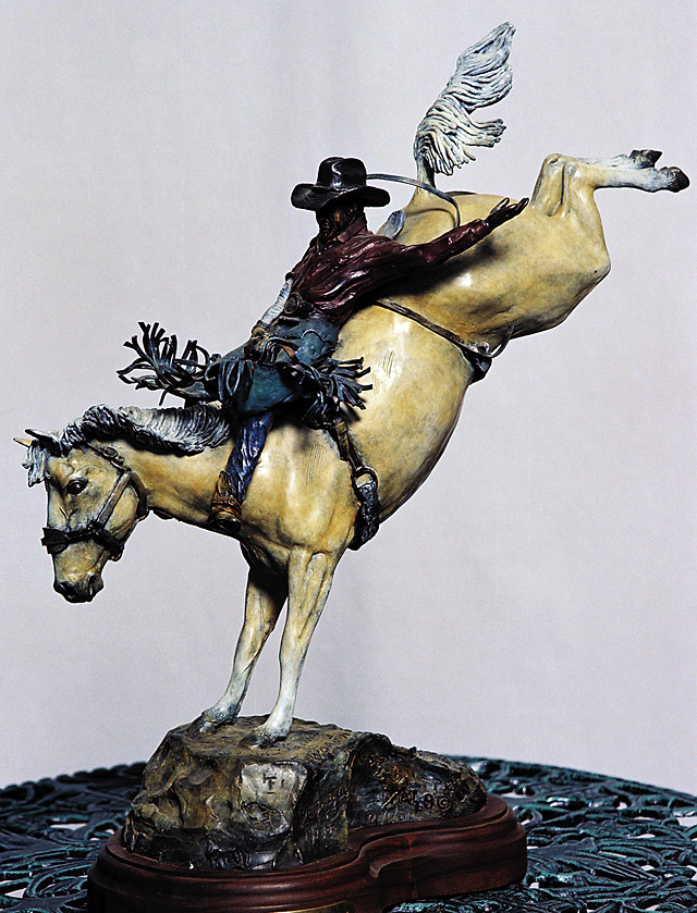 Bronze sculpture by Don Beeler. The cowboy is J.C. Trujillo riding his horse named Smith Velvet. Trujillo is a world champion bareback rider and his horse is also a world champion.