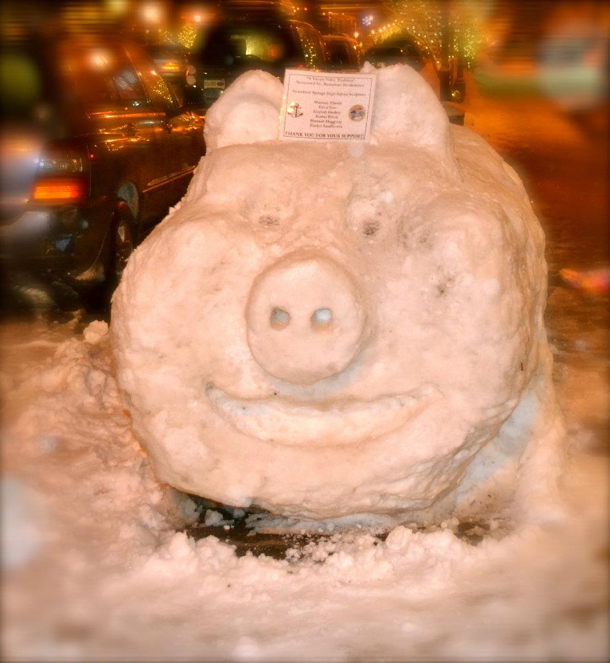 Snow sculpture of a pig sits along Lincoln Avenue as part of the Winter Carnival festivities. Submitted by: Amy Johnson
