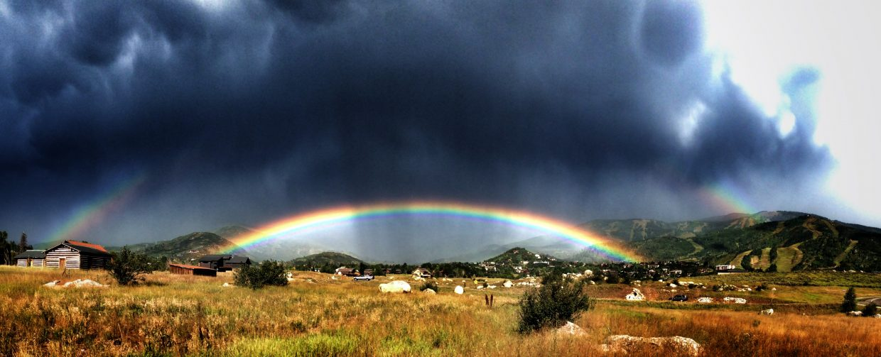 Storm cloud vs. double rainbow near Steamboat Ski Area. Submitted by: Chris Lanham