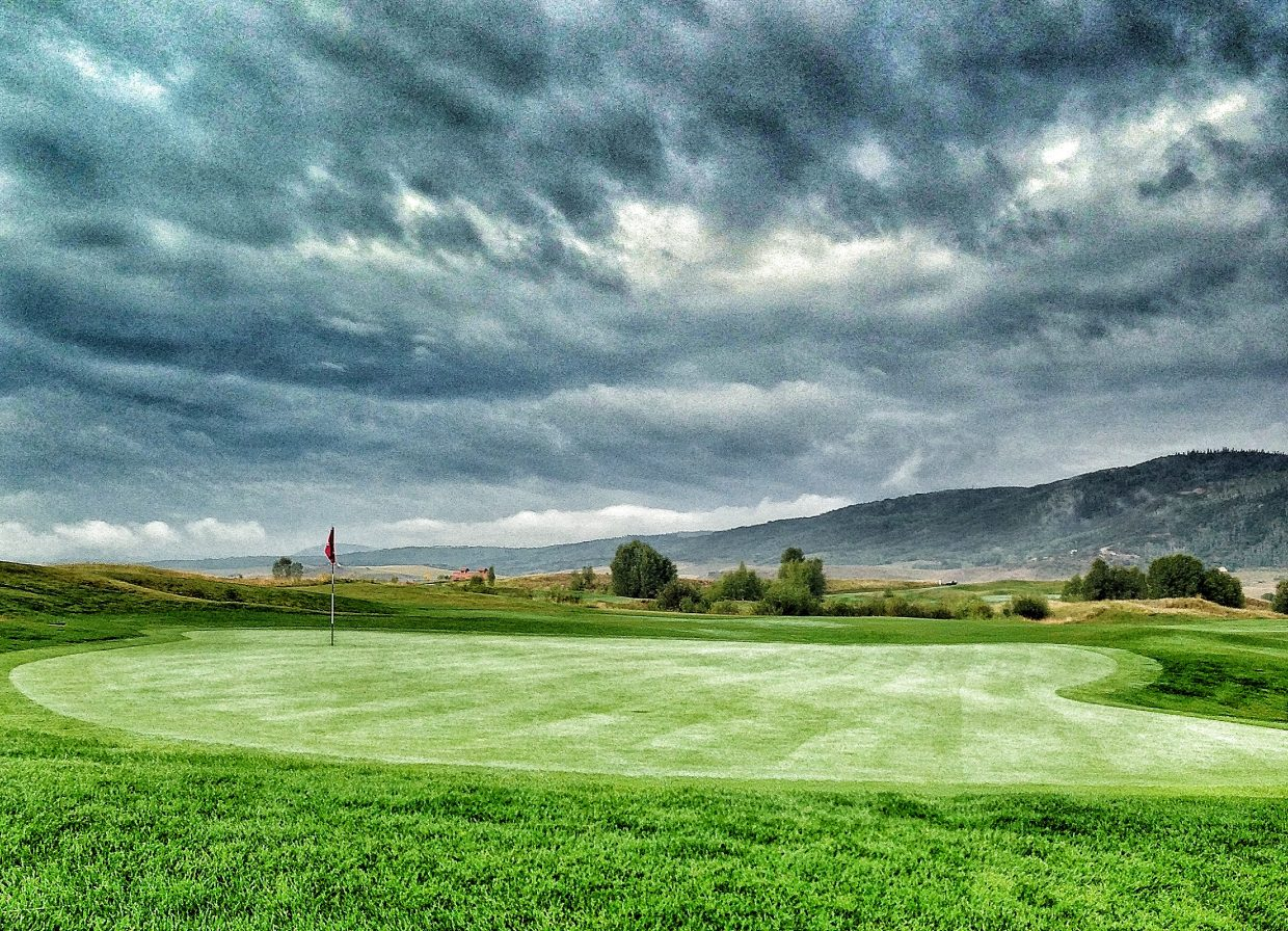 Storm hovering over Emerald Mountain and Haymaker Golf Course. Submitted by: Chris Lanham