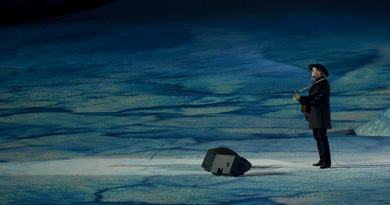 Neil Young performs at the Olympic closing ceremonies.