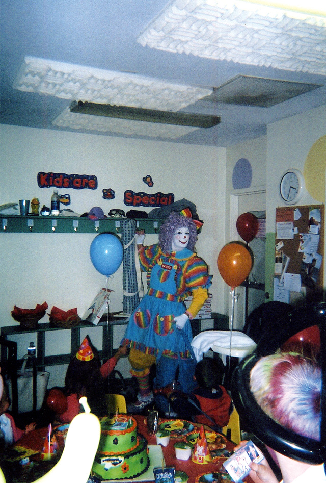 Susan Merrill's Watoosie the clown character performs at McKenna Ray's third birthday party last October.
