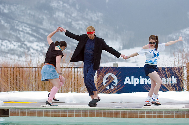 Team Totally Tubular does the pre-plunge '80s dance at the Penguin Plunge on Saturday at Lake Catamount. Team members are Alexis DeLaCruz, from left, Matt Stensland and Allison Plean.