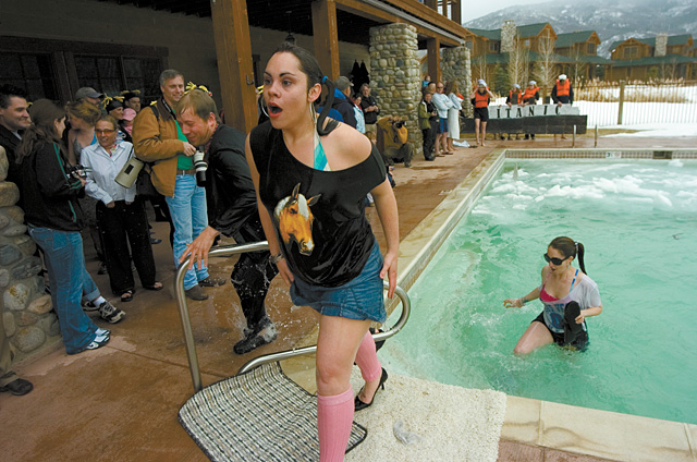 Team Totally Tubular members do the jump, feel the shock, save the flip-flops and escape from the pool. Proceeds from the Penguin Plunge benefit Yampa Valley Medical Center's emergency department.