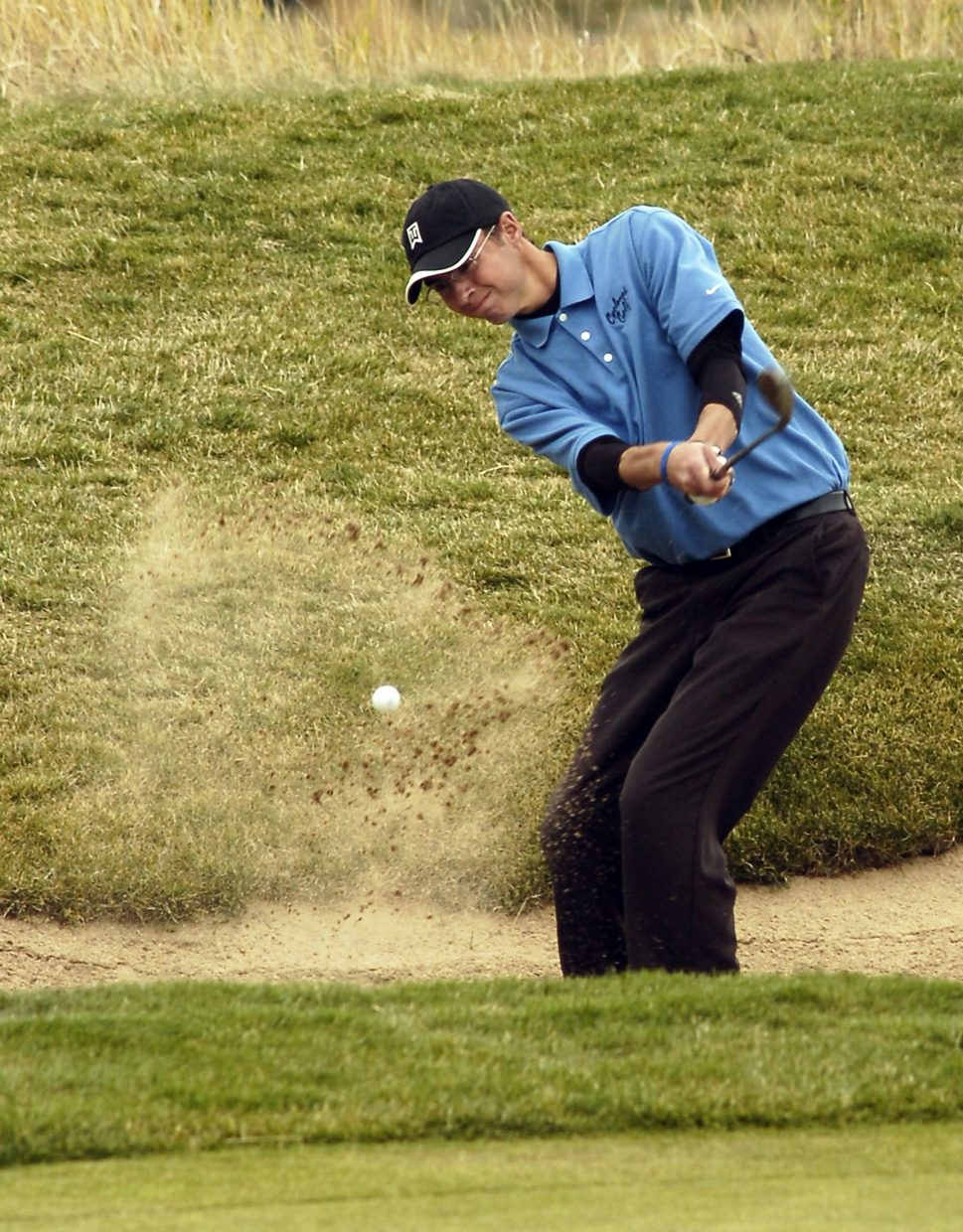 Pueblo West golfer Zane Covey chips out of the sand on the No. 9 hole at Steamboat Springs' Haymaker Golf Course during the Class 4A State High School Golf Championships on Monday. Covey finished the round with an 80.