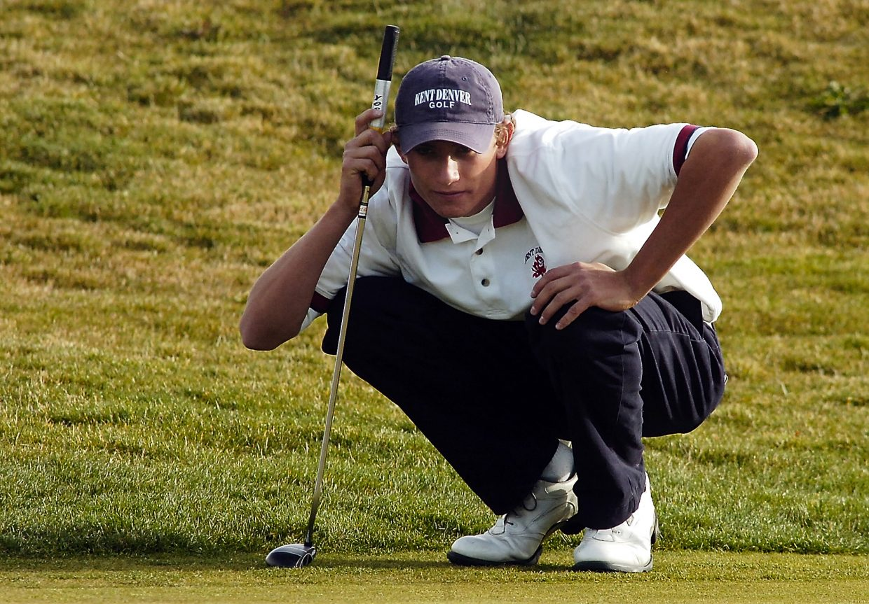 Kent Denver's Gunner Wiebe lines up a putt on the No. 18 hole at Haymaker Golf Course in Steamboat Springs on Monday. Wiebe shot a round of 68 and is in second place after the first day of the Class 4A Colorado State High School Golf Championship.