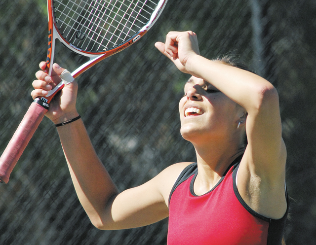 Breanne Murray raises her hand in victory and relief after winning a first-set tiebreaker against Mullen's Cari Hudson Friday morning at the 2007 Girls State Tennis Tournament. Murray went on to win the match 7-6 (3) 4-6, 6-2 and will play for the state title in today's finals.