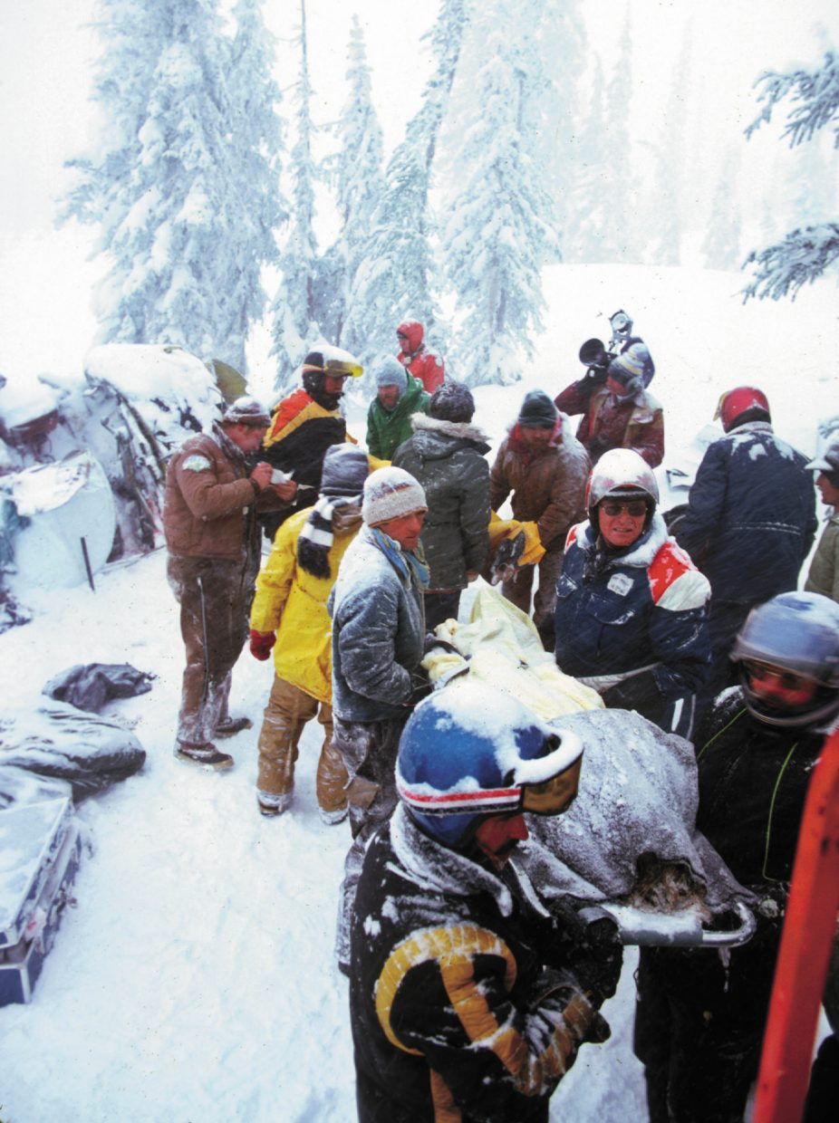 Rescuers remove a passenger from the crash site on Buffalo Pass on the morning of Dec. 5, 1978. One passenger died in the crash, and the pilot died of his injuries three days later.