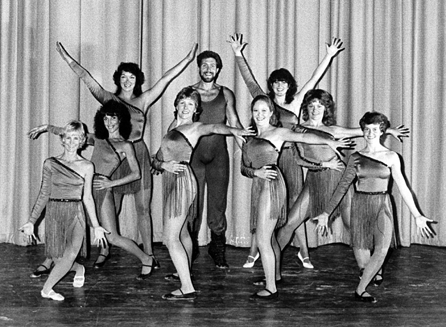 "Gigi Walker, Karen Jimmerson, Annie York, Karin Comeau, Sid Lewis, Alice (Leipold) Barratt, DeLisa (Myles) Montoya, Polly Idol Cogswell and Sue McDougall pose for ""Flashdance"" circa 1980's."