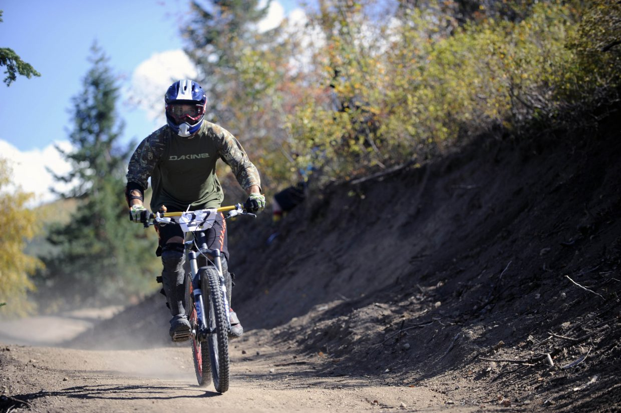 Joe Love rides down the trail during the second annual Steamboat Springs Bike Summit downhill race. Love finished two runs in a combined 7 minutes and 56 seconds for 12th place.