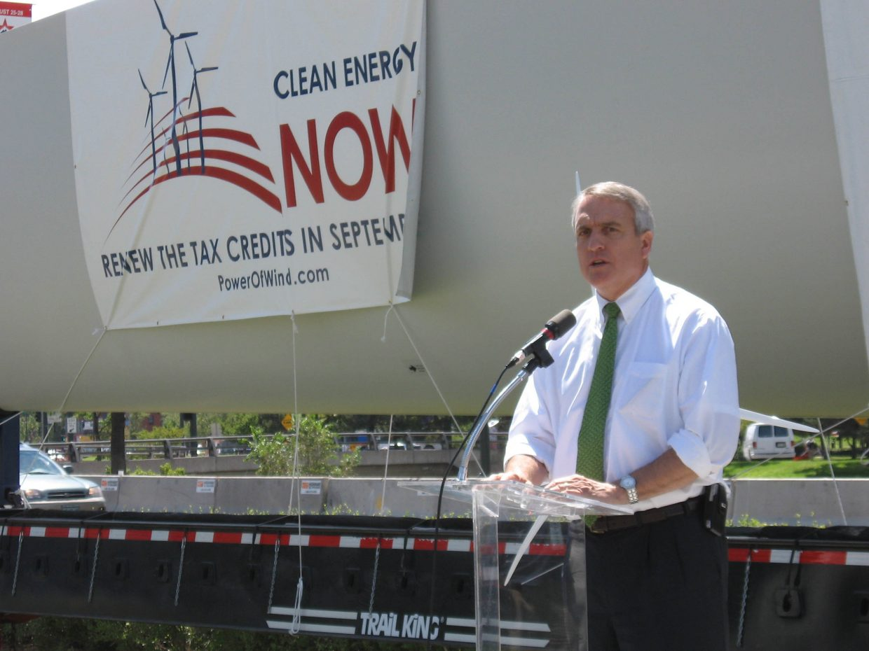 Gov. Bill Ritter speaks in front of a 130-foot wind turbine blade Tuesday outside the Denver Center for Performing Arts. Speaking to an international crowd on the second day of the Democratic National Convention, Ritter said the Danish blade manufacturing company Vestas will bring 2,500 jobs and a $700 million investment to Colorado in coming years.