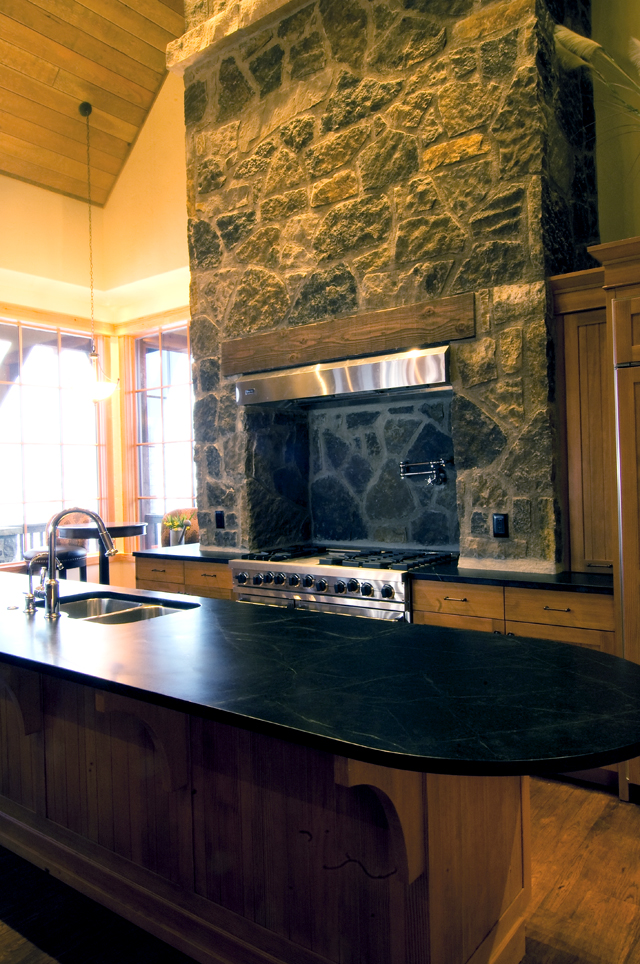 Mike Bell built the kitchen chimney to look as though an old wood-burning stove had been removed and a modern range was inserted into the alcove in its place. The entire home was designed to look like an old ranch home that has been updated.
