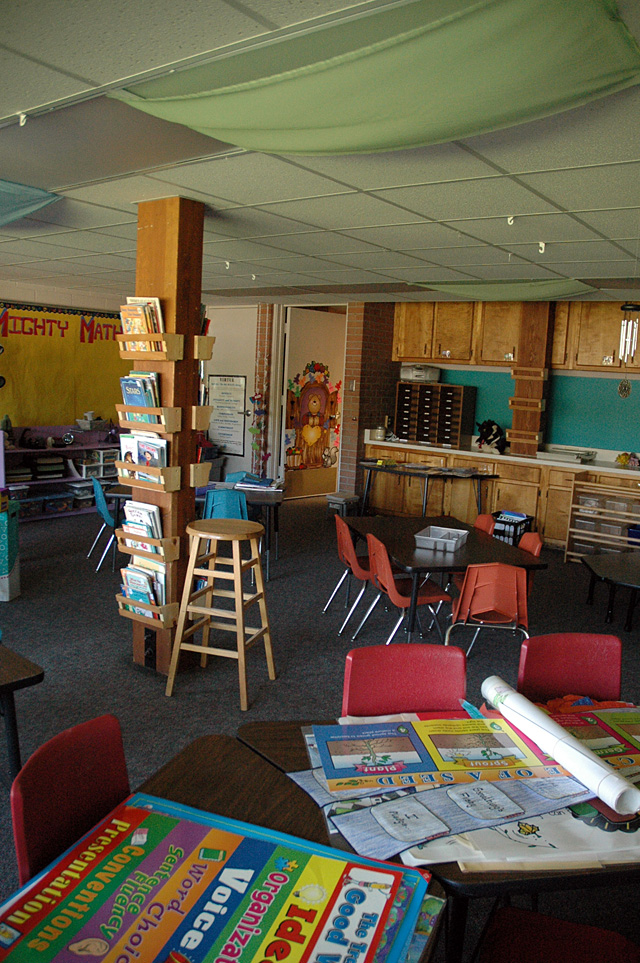 The pole in this first-grade classroom makes it difficult for a teacher helping students in the reading area, foreground, to keep an eye on students sitting at desks near the door.