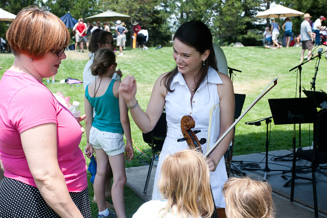 Cellist Kimberly Patterson talks with audience members after the Tesla Quartet performance at Music on the Green. Submitted by: George Fargo