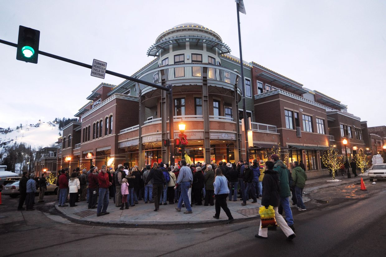 A crowd gathers at the corner of Seventh Street and Lincoln Avenue on Friday evening for the unveiling of a statue of local skiing legend Carl Howelsen.