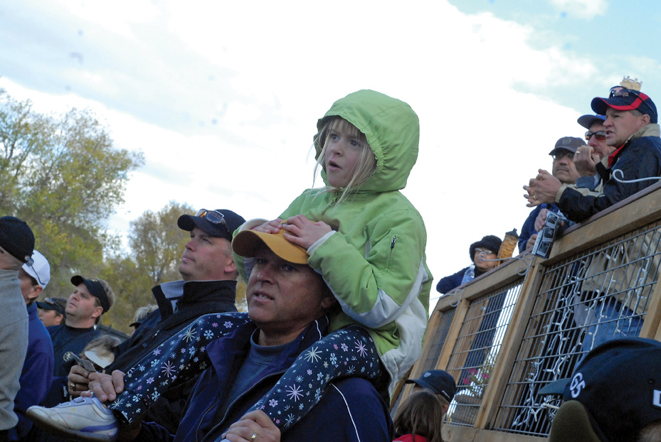 Meghan Otte sits on her father's shoulders attempting to get a better look at the action Monday during the 4A high school golf state championships. The Otte's were part of the more than 300 spectators who witnessed the first round of the finals at Yampa Valley Golf Course.