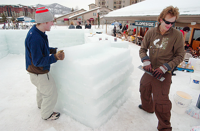 Paul Hamburger, right, and Zack Borngraver help Slopeside Grill owner Chris Corna construct his outdoor bar made from blocks of ice. Corna said he has been building the ice bar for 12 years.