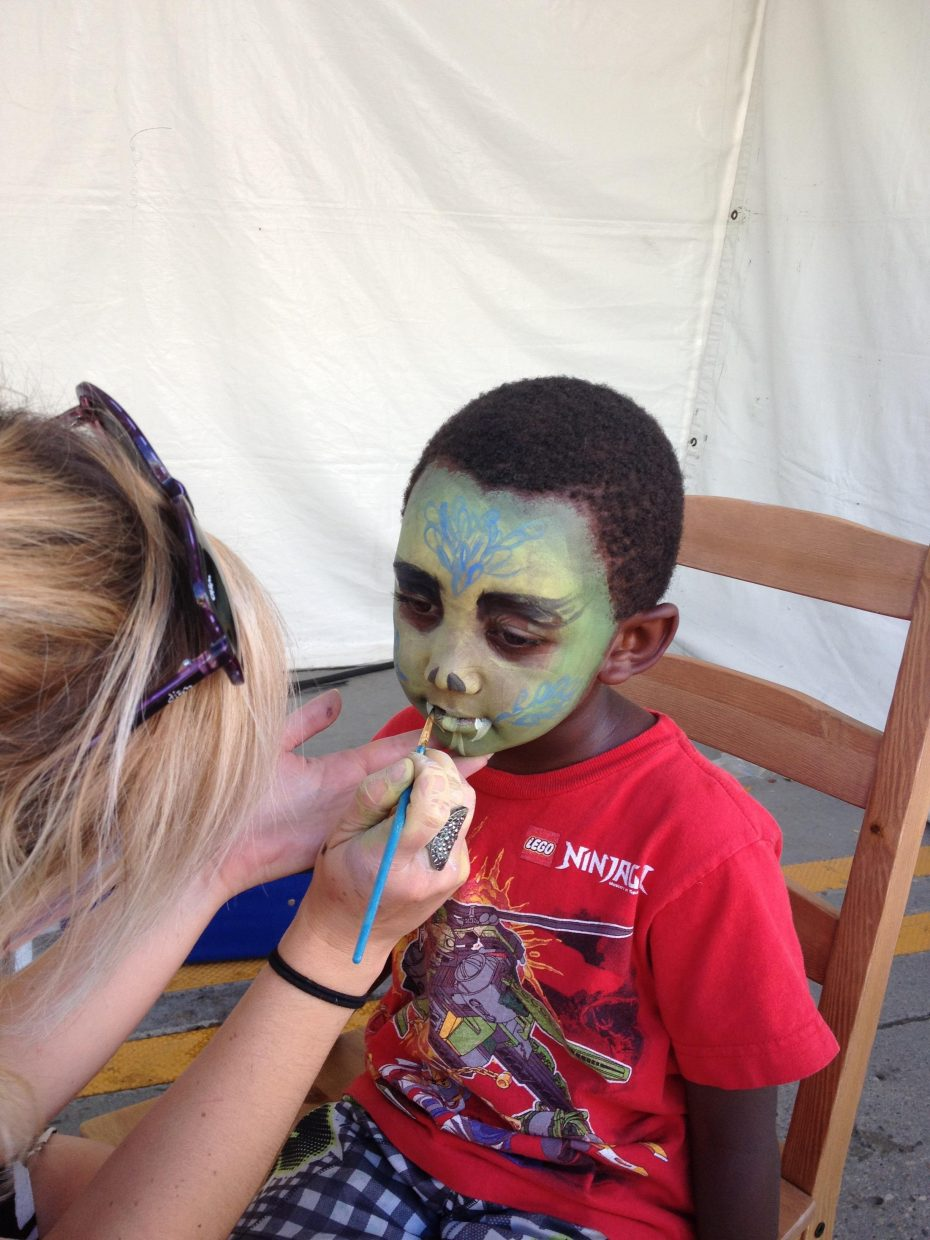 Taye Dover getting his face painted at the US Pro Challenge on Wednesday in Steamboat. Submitted by Michelle Dover