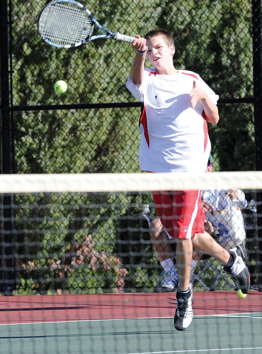 Steamboat's No. 3 singles player Jack Burger returns a shot during the opening day of the state high school tennis tournament in Pueblo. Burger defeated Matthew Jordan, of D'Evelyn, 6-0, 6-1, to advance to the quarterfinals.