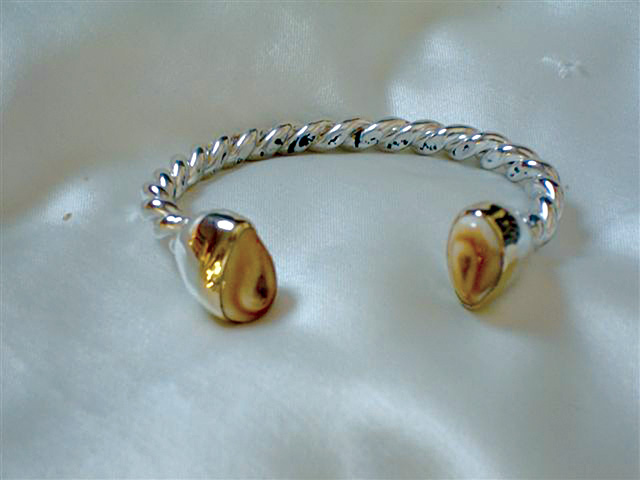 This bracelet was made with elk teeth, which is the only form of ivory that can be found within continental North America.