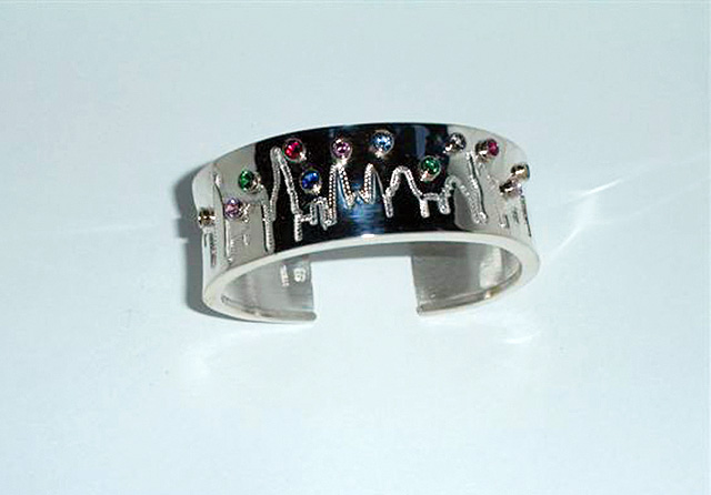 Sarah Buckles Larner designed this bracelet with the New York skyline for a woman with the birthstones of her grandchildren.