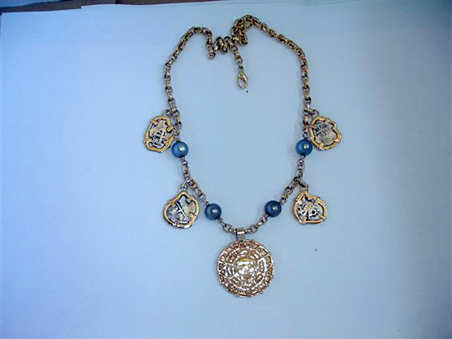 The custom-made doubloon necklace Sarah Buckles Larner designed for a man's wife for their tenth anniversary. She loved the Florida Keys.