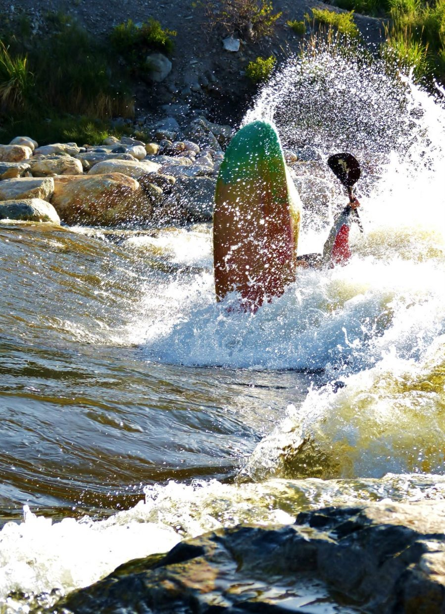 Justin Owen, who is in town for the Yampa River Festival competitions, lands a huge loop. Submitted by Matt Helm