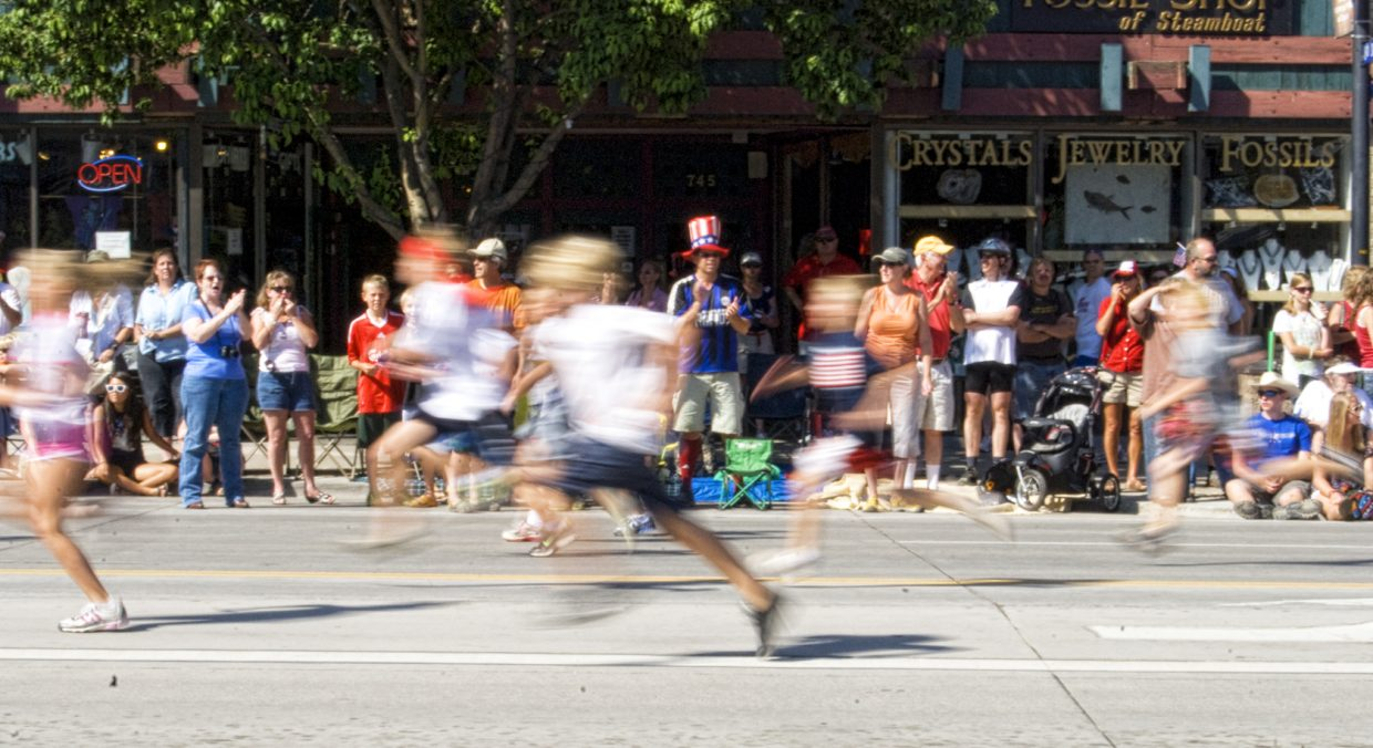 Spectators watch the Steamboat Sprint race in downtown Steamboat Springs on Monday.