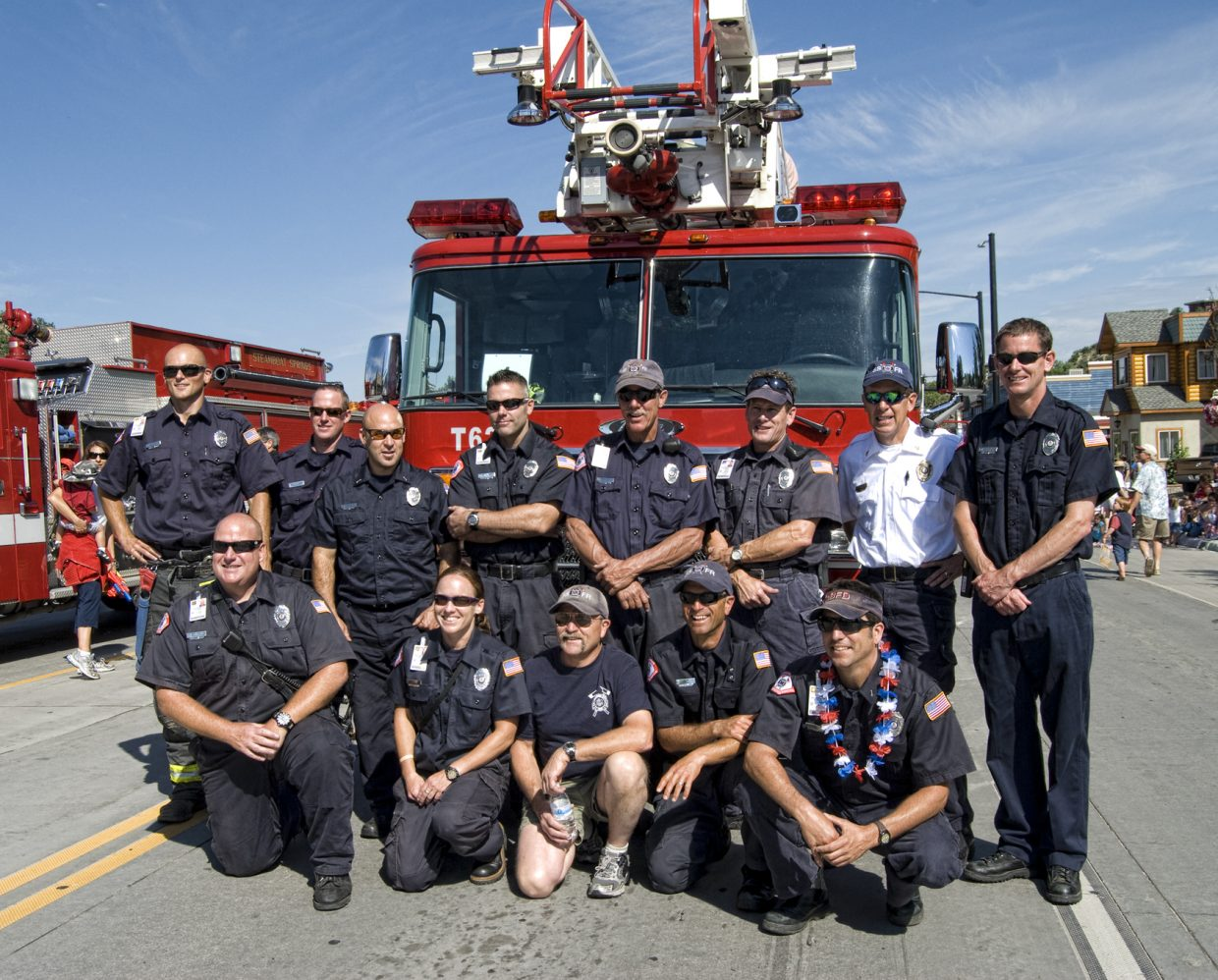 Steamboat Springs firefighters line up for a photo during the Steamboat Fourth of July Parade in downtown Steamboat on Monday.