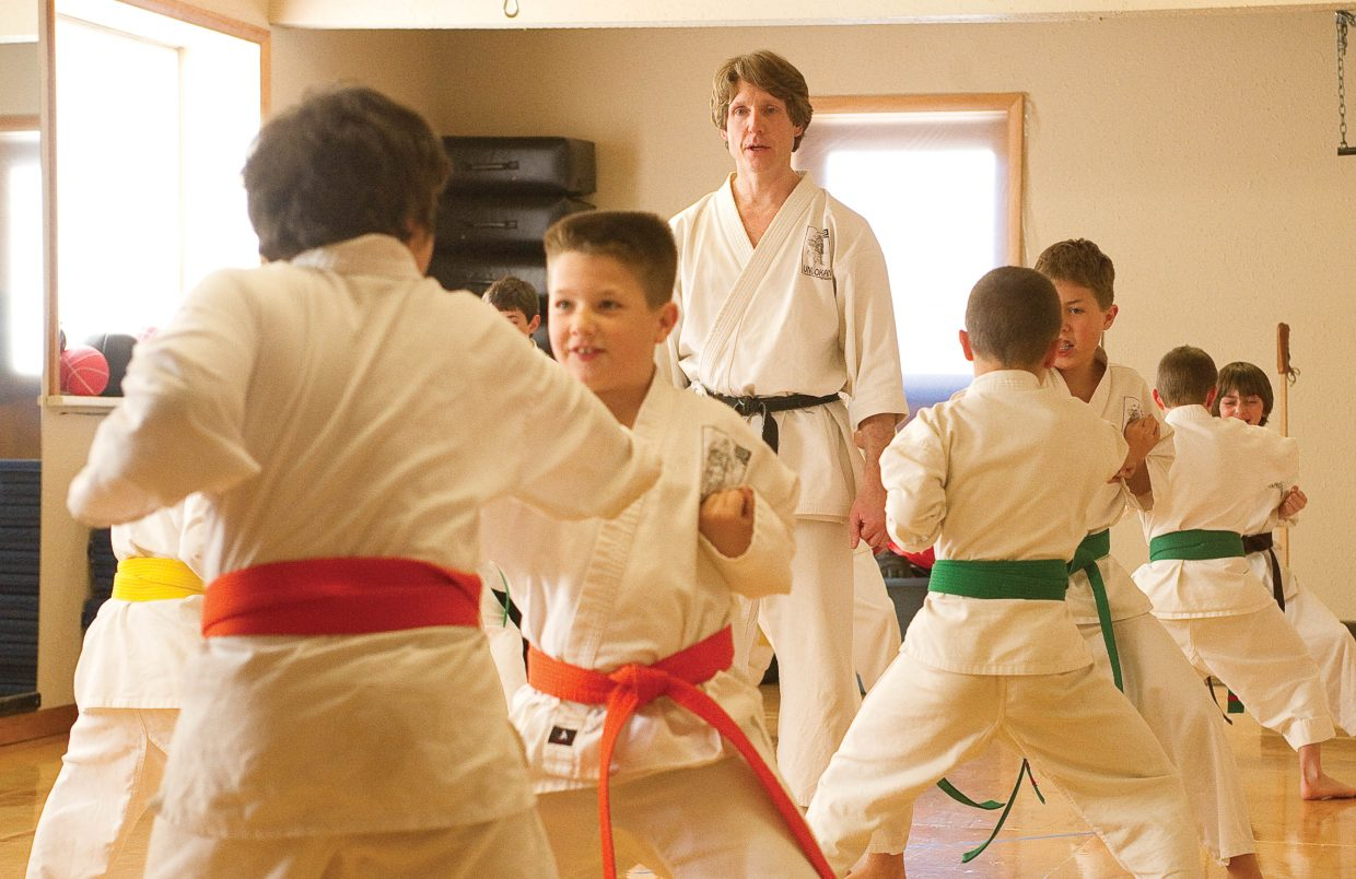 Michael David Bauk instructs a class of young karate students at the Rocky Mountain Karate Academy.