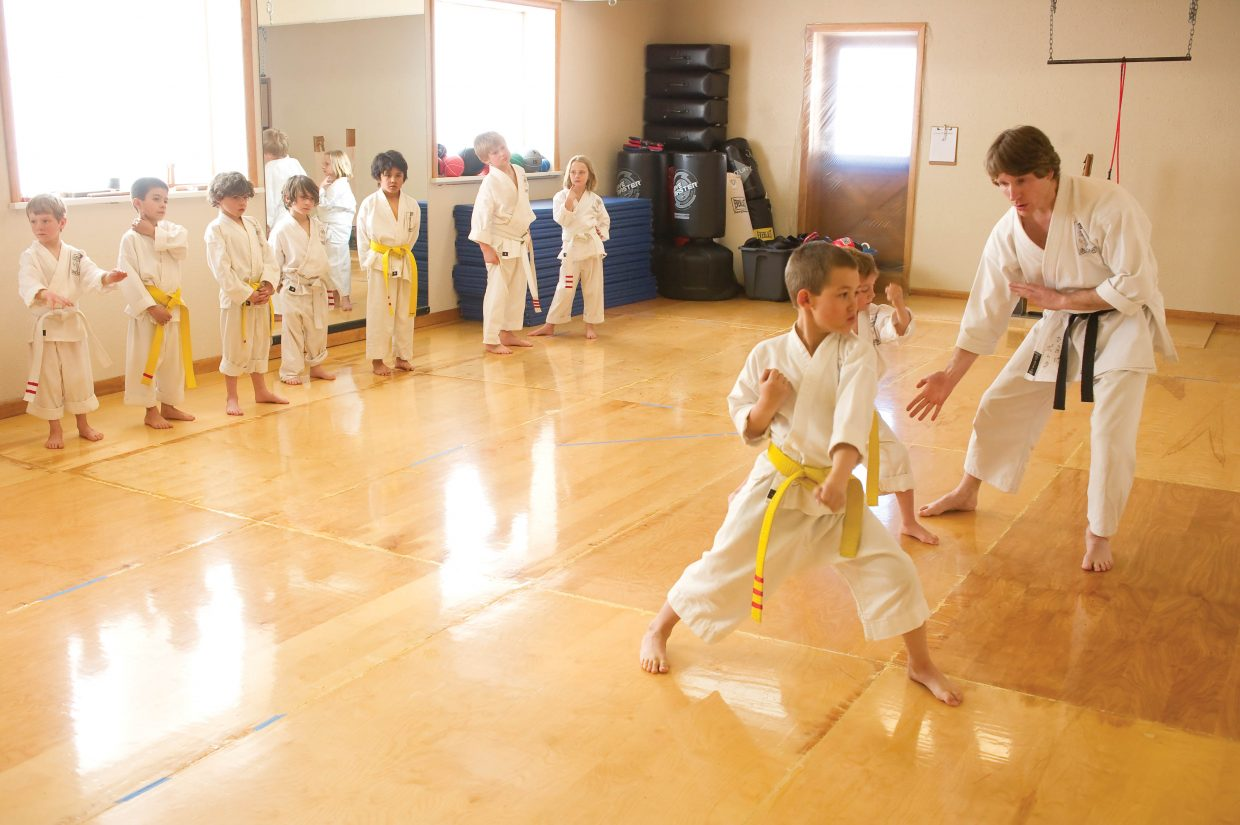 Sensei Michael David Bauk works with his young karate students at the Rocky Mountain Karate Academy in Steamboat Springs earlier this week. Bauk will celebrate 10 years as a karate instructor in Steamboat Springs in the spring.