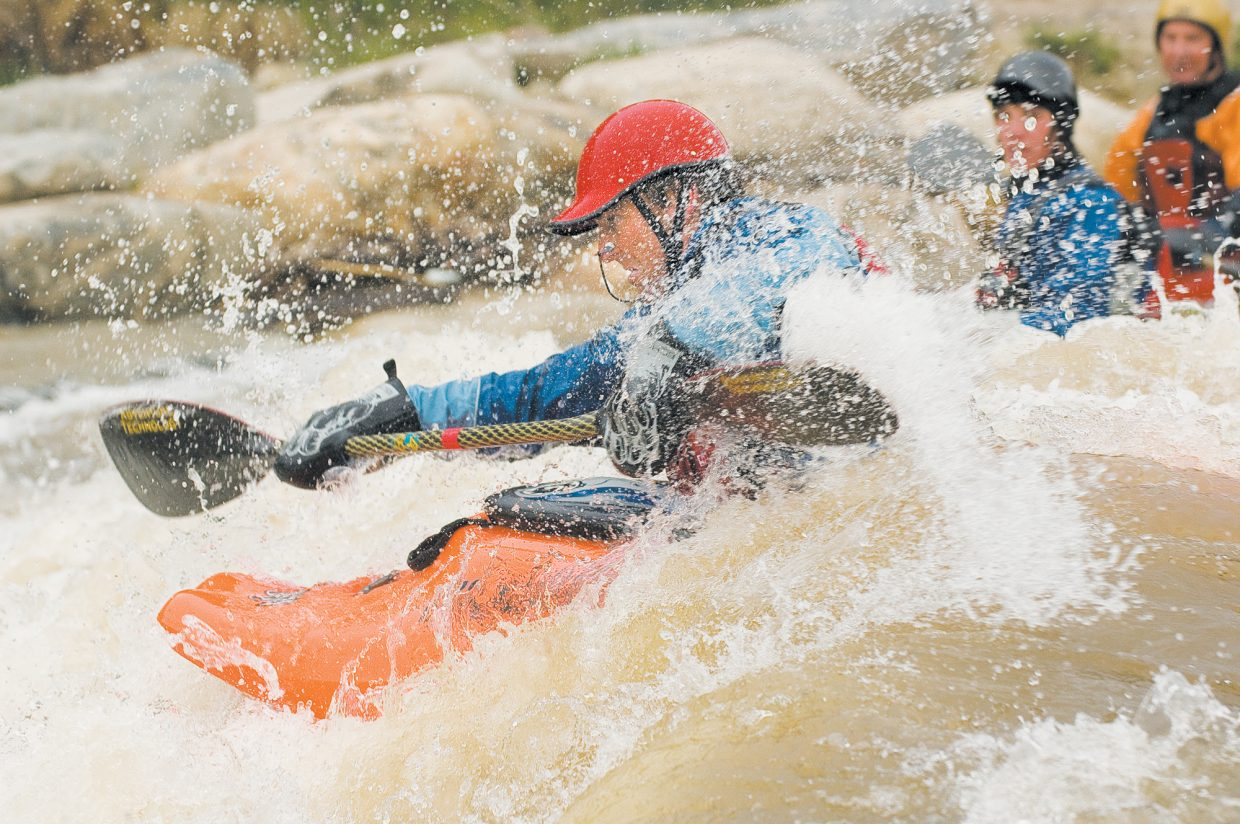 Water flies around Joe Carberry as he plays in the white water of the Yampa River just behind the Bud Werner Memorial Library. Carberry was one of several kayakers playing in the river last week and celebrating a great spring runoff.